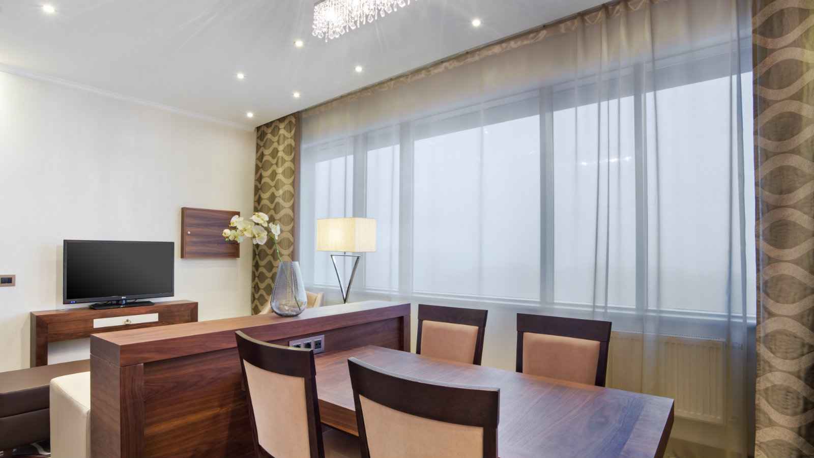 Family dining or meeting table for 4 persons in Studio Suite at Sheraton Moscow Sheremetyevo